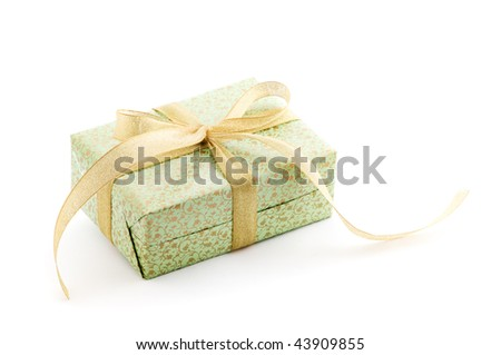 green gift box with gold ribbon - stock photo