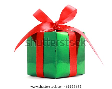 Green gift wrapped present with red satin ribbon bow isolated on white