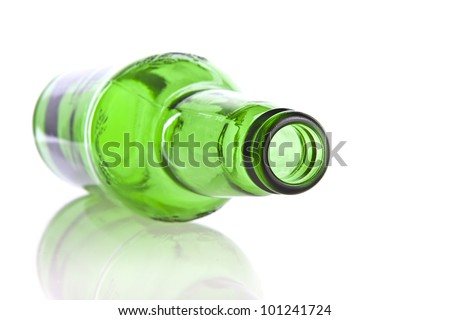 Green glass bottle isolated on a white background