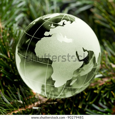 Green Glass globe Christmas tree on the background mast