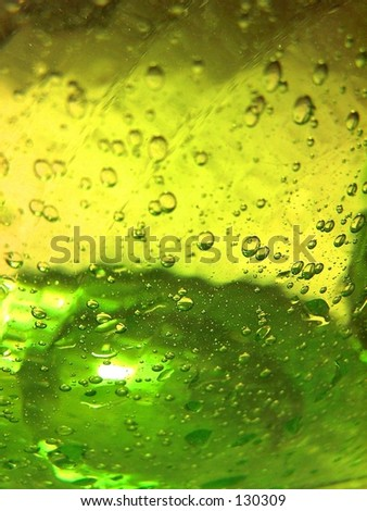 green glass vase with water inside
