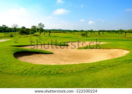 green golf field and blue cloud sky for backdrop background use #522500224