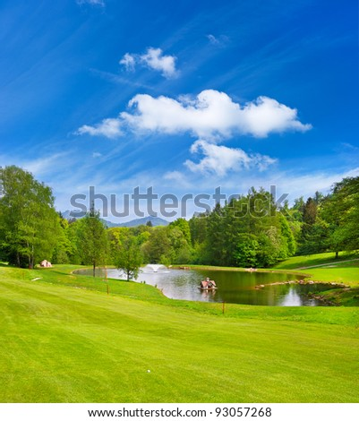 green golf field with blue sky. european golf course landscape