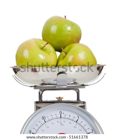 Green granny smith apples on a scale with a white background - stock photo