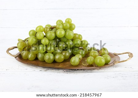 Green grape on tray on wooden background #218457967