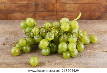Green grape on wooden table on wooden background #213904429