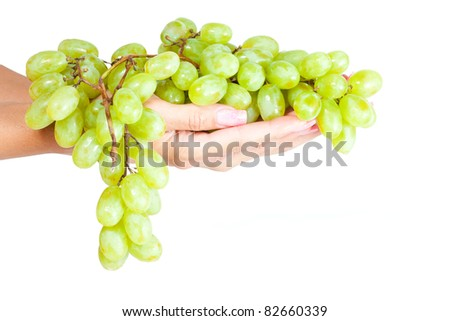 Green grapes in her hand. Isolation