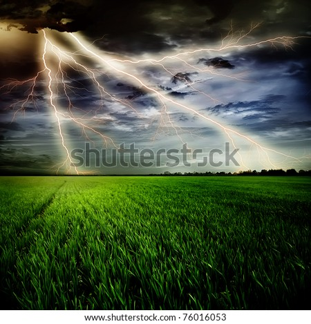 Stock Photo Green grass against a stormy sky