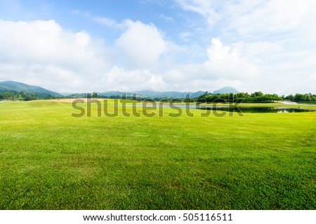 green grass field on blue sky with cloud background #505116511