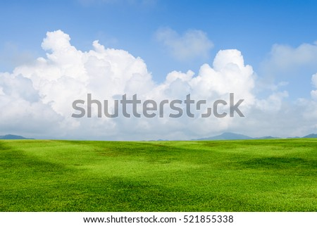 green grass field on blue sky with cloud background #521855338