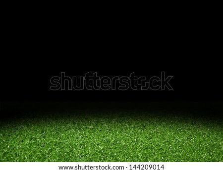 Green grass field with spotlight