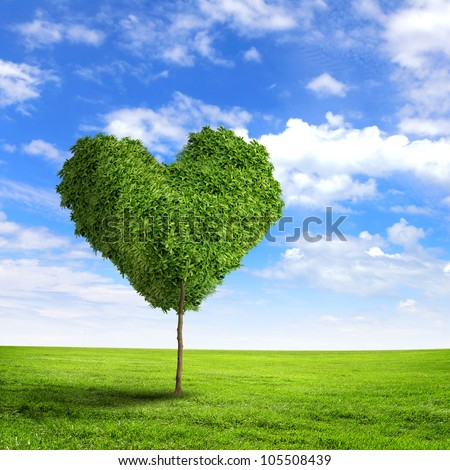 Green grass heart symbol against blue sky