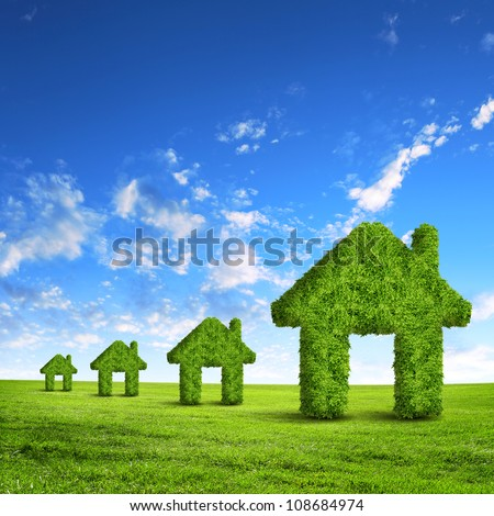 Green grass  house symbol against blue sky
