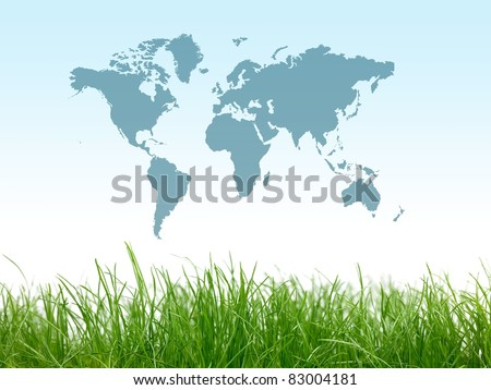 Green grass isolated against a blue sky with a world map