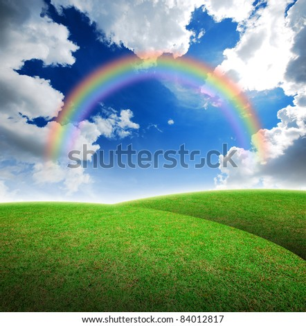 Green grass landscape blue sky for Backgrounds and design rainbow