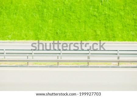 Green grass near highway. Ecology background.