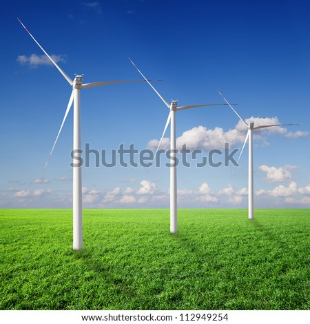 Green grass, the blue sky and white clouds and  wind Power