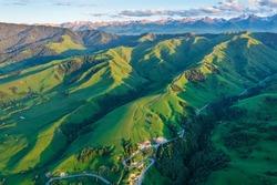 Green grassland and mountain natural landscape in Nalati grassland,Xinjiang,China.Aerial view.Nalati Grassland is China's sky grassland.