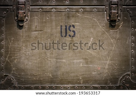 Green grunge military chest background with rivets