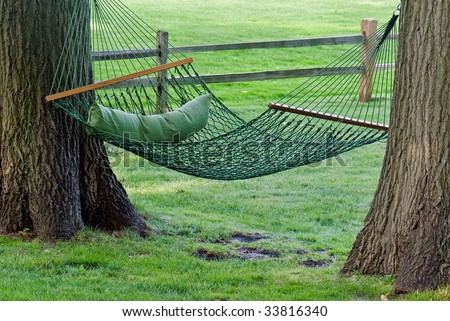 green hammock between old oak trees