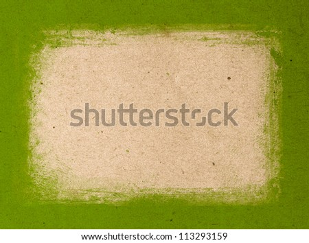 Green hand-painted brush stroke frame background over old vintage paper