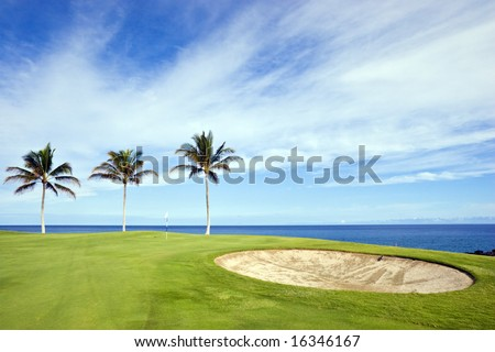 Green Hawaiian Golf Course on Lava Ocean Shore of Kona Island
