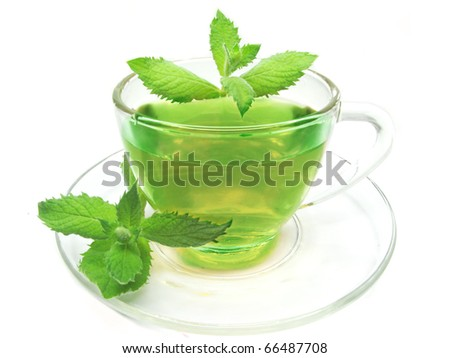 green herbal tea with mint in cup