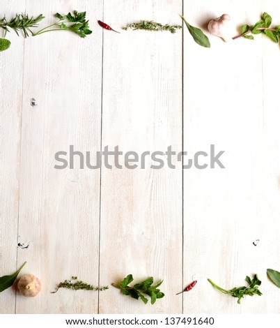 Green herbs with garlic.frame.on white wood background. #137491640