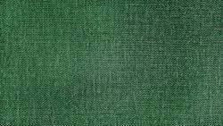 green herringbone tweed pattern, wool fabric background texture. interior material background. illumination background.