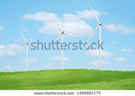 green hill with Wind turbines generating electricity #1488885179