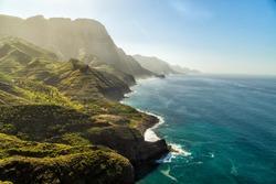 Green hills and cliffs of Tamadaba Natural Park on the coast of the ocean near Agaete, Las Palmas, Gran Canaria island, Spain