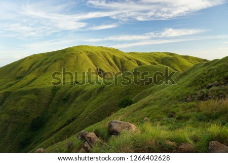 Green hills and meadow in a unmanned beautiful tropical island, peaceful  perfect place for looking for inspiration #1266402628