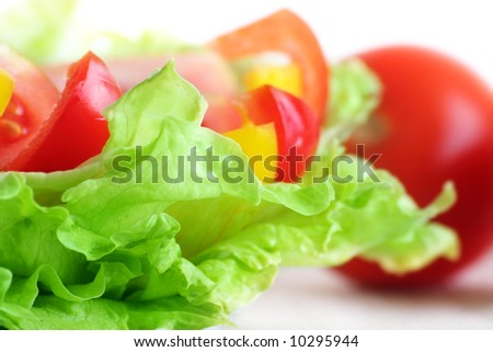 green iceberg salad with red and fresh tomatoes