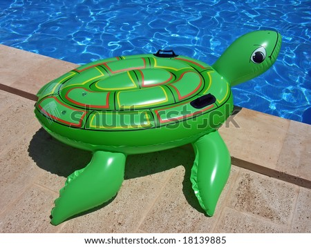 Green Inflatable Turtle On The Edge Of A Swimming Pool Stock Photo 18139885 Shutterstock