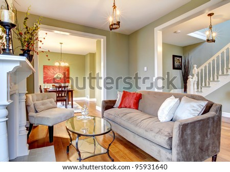 Green interior with cherry wood floor and nice furniture.