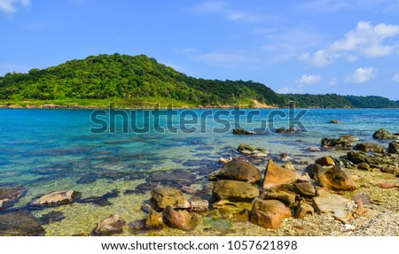 Green island with beautiful beach at sunny day in summer. #1057621898