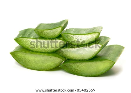 Green juicy slices of aloe vera isolated on white. Photo taken on: September 27th, 2011