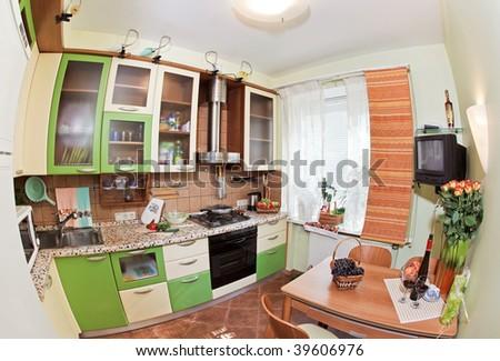 Green Kitchen interior with many utensils and window, fisheye View - stock photo