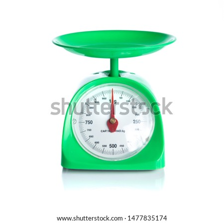 Green kitchen scales isolated on white background