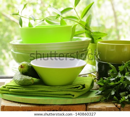green kitchen utensils on a wooden table