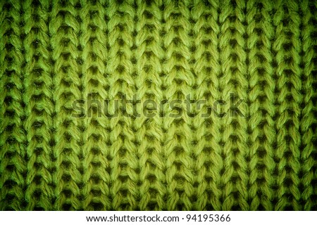 Green knitted wool background