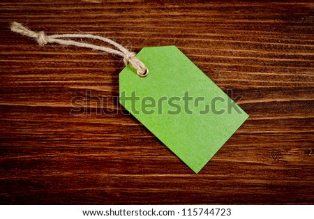 Green label on the wooden background
