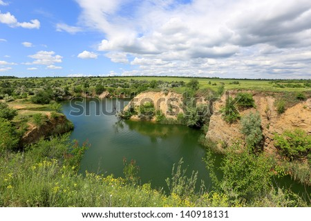 Green lake in steppe in nice summer day