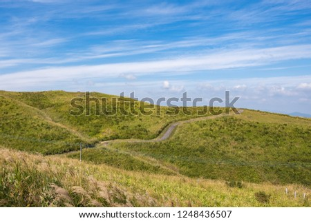 Green lanscape with mountain Aso background, view at the top of mountain from Daikanbō Mount Aso, Aso, Kumamoto, Kyushu, Japan