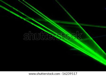 Green lasers background on black