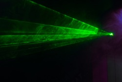 Green lasers for show in smoke