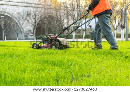 green lawn with hay mover #1273827463