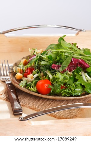 green leaves salad on serving tray