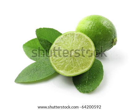 Green lemons with leaves on white background