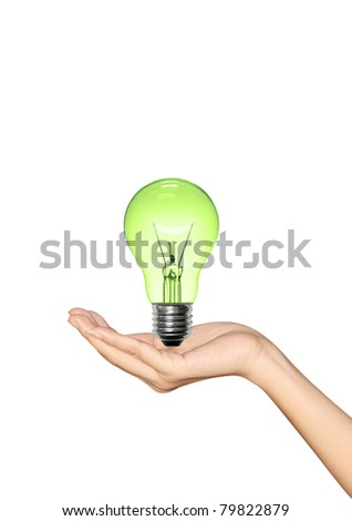 Green Light bulb in hand woman on white background